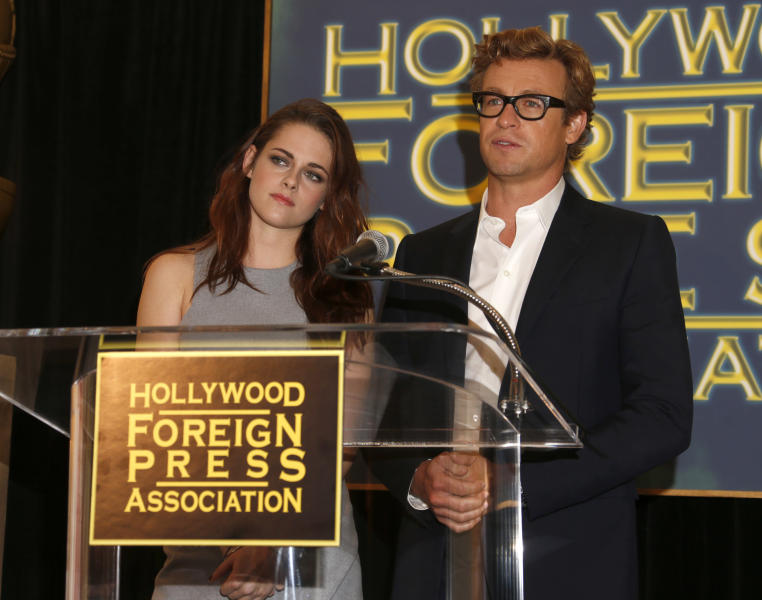Actors Kristen Stewart, left, and Simon Baker appear at a news conference to announce that Jodie Foster will be the next recipient of the Cecil B. DeMille Award, Thursday Nov. 1, 2012, in Beverly Hills, Calif. Foster will receive the award at the 70th annual Golden Globes ceremony on Jan. 13. (Photo by Todd Williamson/Invision/AP)