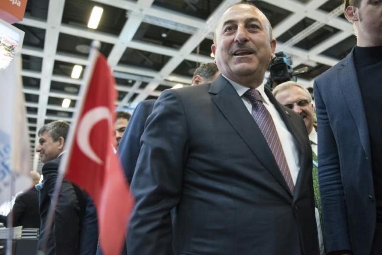 "Cavusoglu, speaking in Istanbul, said the ban was ""unacceptable"""