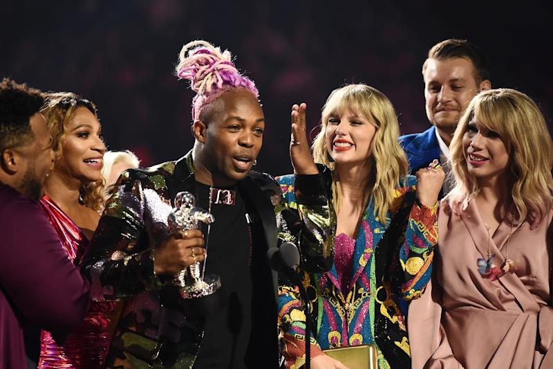 """Swift and co-exectuive producer Todrick Hall accept the Video of the Year award for """"You Need to Calm Down."""" (Photo by Dimitrios Kambouris/VMN19/Getty Images for MTV)"""