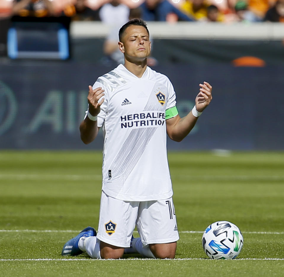 "HOUSTON, TEXAS - FEBRUARY 29: Javier ""Chicharito"" Hernandez #14 of Los Angeles Galaxy takes a moment of silence before playing the Houston Dynamo at BBVA Stadium on February 29, 2020 in Houston, Texas. (Photo by Bob Levey/Getty Images)"