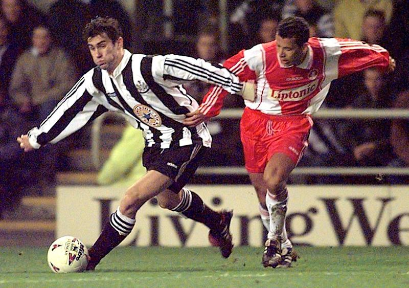 Newcastle United 's striker Keith Gillespie (L) against AS Monaco 's Lilian Martin in 04 March 1997 .