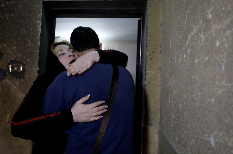 Palestinian journalist, Yaghi, hugs his mother, Zouheir, after 20 years of separation in Banha