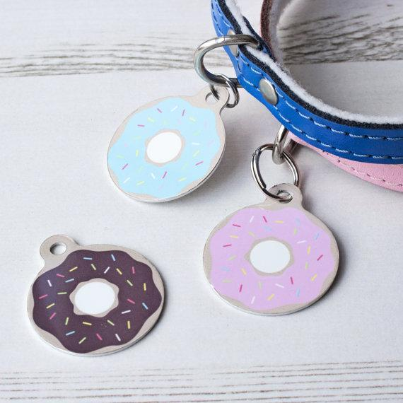 """<p>Double sided pet ID tag with a doughnut print. Choose from a range of 'toppings' to create a sweet tag for your cat or dog. Tags are double sided so you can include important details on the reverse.<br></p><p>£7 <a href=""""https://www.etsy.com/uk/listing/450947208/donut-pet-id-tag-personalised-dog?ga_order=most_relevant&ga_search_type=all&ga_view_type=gallery&ga_search_query=pet&ref=sr_gallery_9"""" rel=""""nofollow noopener"""" target=""""_blank"""" data-ylk=""""slk:We Love Pets"""" class=""""link rapid-noclick-resp"""">We Love Pets</a></p>"""