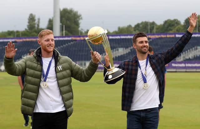 Ben Stokes (left) and Mark Wood celebrate with Cricket World Cup in Durham (PA)