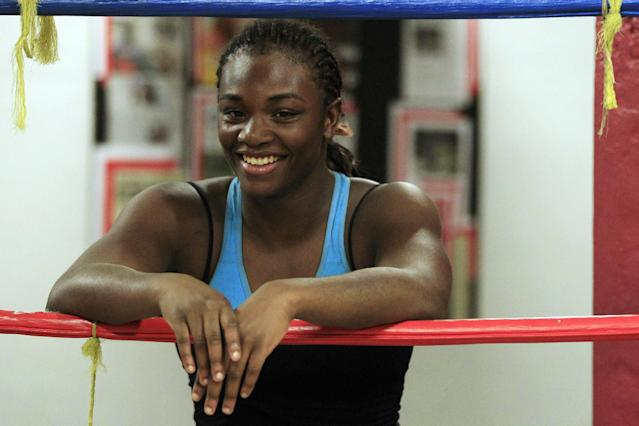 In this Sept. 18, 2012, photo, Olympic gold medal boxer Claressa Shields takes a break during workouts at the Berston Field House in Flint, Mich. The ferociousness that won Shields an Olympic gold medal melted away as she climbed on the podium to claim it. (AP Photo/Carlos Osorio)