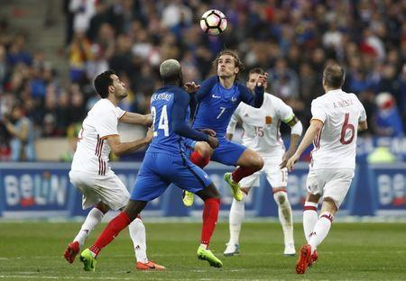 Football Soccer - France v Spain - International Friendly - Stade de France, Saint-Denis near Paris, France - 28/3/17 France's Antoine Griezmann and Tiemoue Bakayoko in action with Spain's Sergio Busquets Reuters / Gonzalo Fuentes Livepic