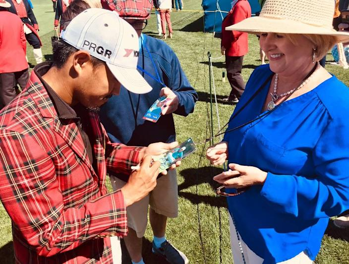 2018 champion Satoshi Kodaira signs autograph for a fan following the opening ceremonies for the 51st RBC Heritage Presented by Boeing on Monday, April 15, 2019, at the Harbour Town Golf Links in Sea Pines on Hilton Head Island.
