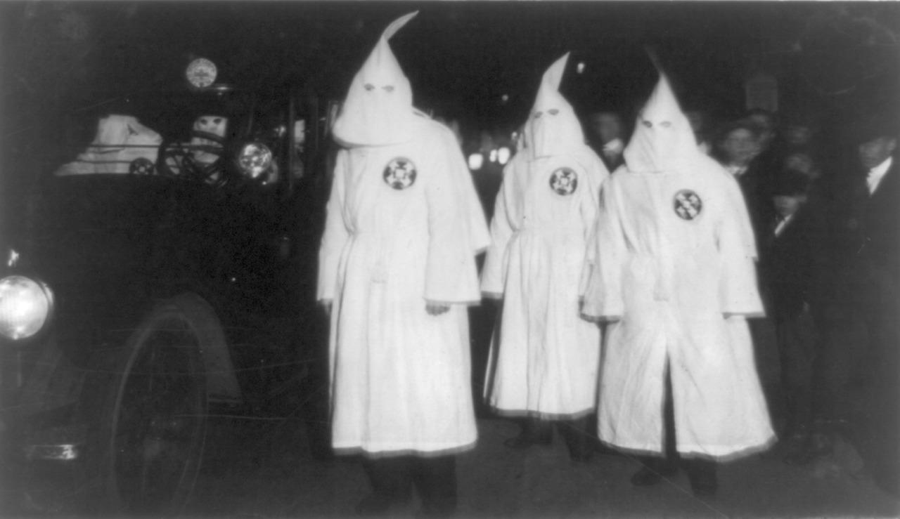 <p>Three Ku Klux Klan members standing beside automobile driven by Klan members in March, 1922. (Photo: Universal History Archive/Getty Images) </p>