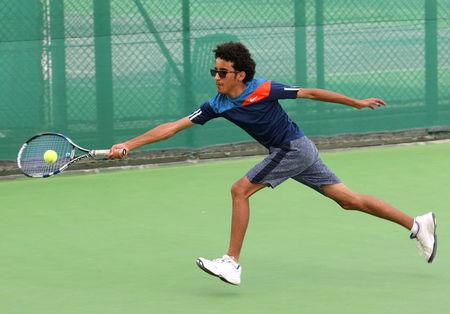 Suhail Alsaeedi from Sanaa, 13, competes during a match in the Asia under 14 Championship tournament in Doha