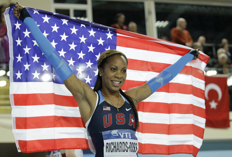 United States' Sanya Richards-Ross celebrates winning the gold in the Women's 400m final during the World Indoor Athletics Championships in Istanbul, Turkey, Saturday, March 10, 2012. (AP Photo/Matt Dunham)