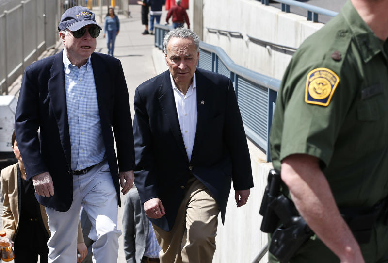 U.S. Sen. John McCain, R-Ariz., left, and Sen. Chuck Schumer, D-N.Y., tour the Nogales port of entry during their tour of the Mexico border with the United States on Wednesday, March 27, 2013, in Nogales, Ariz. (AP Photo/Ross D. Franklin)