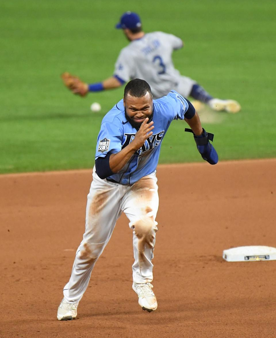Manuel Margot takes off for third base on a throwing error after he stole second during the fourth inning.