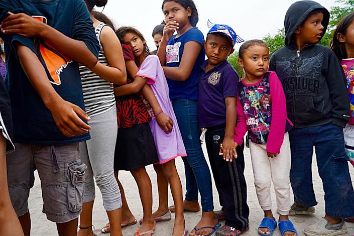 Children and adults in line