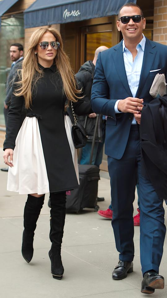 "<p>Lopez and her new beau tooks to the streets of N.Y.C. on Thursday—Rodriguez looked dapper in a navy blue suit, while J.Lo flaunted her fashion icon status in a collared A-line minidress with white side panels, platform over-the-knee boots (shop a similar look <a rel=""nofollow"" href=""https://click.linksynergy.com/fs-bin/click?id=93xLBvPhAeE&subid=0&offerid=483151.1&type=10&tmpid=5462&RD_PARM1=http%253A%252F%252Fwww.neimanmarcus.com%252FStuart-Weitzman-Demistrong-Suede-Over-the-Knee-Boot-Black%252Fprod181140144%252Fp.prod%253F&LSNSUBSITE=LSNSUBSITE&u1=ISJLoSSPlatformBootsIJApril"">here</a>), and reflective aviator shades (shop a similar look <a rel=""nofollow"" href=""https://click.linksynergy.com/fs-bin/click?id=93xLBvPhAeE&subid=0&offerid=484990.1&type=10&tmpid=23604&RD_PARM1=https%253A%252F%252Fwww.shopbop.com%252Fplaya-sunglasses-quay%252Fvp%252Fv%253D1%252F1518230472.htm%253FfolderID%253D2534374302024641%2526fm%253Dother-shopbysize-viewall%2526os%253Dfalse%2526colorId%253D18270%2526extid%253Daffprg_linkshare_SB-%252A2nGiS3mv0Y%2526cvosrc%253Daffiliate.linkshare.%252A2nGiS3mv0Y&u1=ISJLoSSAviatorsIJApril"">here</a>), a quilted Chanel bag draped over her left shoulder. </p>"