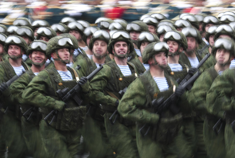 In this photo taken with long time exposure, Russian paratroopers march toward Red Square during the Victory Day military parade in Moscow, Russia, Sunday, May 9, 2021, marking the 76th anniversary of the end of World War II in Europe. (AP Photo)
