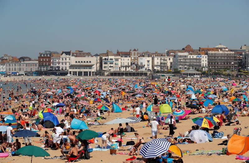 FILE PHOTO: People enjoy the hot weather on Margate beach in Margate