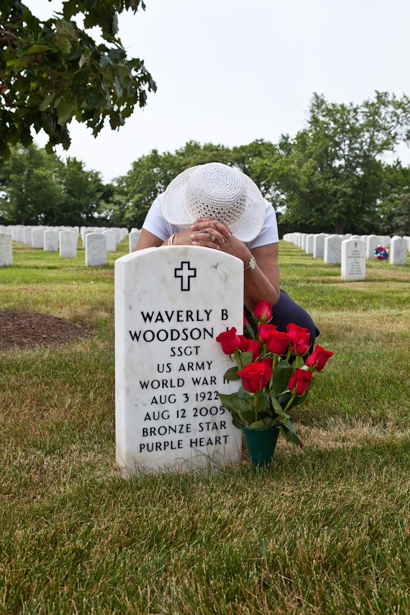 Joann Woodson visits her husband's grave at Arlington National Cemetery with his favorite red roses. | Linda Hervieux