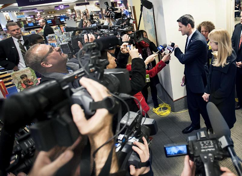 Rep. Paul Ryan and his wife Janna, right, answer questions from local and region press organizations after voting at the Hedberg Public Library in Janesville, Wis., on election day, Tuesday, Nov. 6, 2012.  (AP Photo/The Janesville Gazette, Mark Kauzlarich)