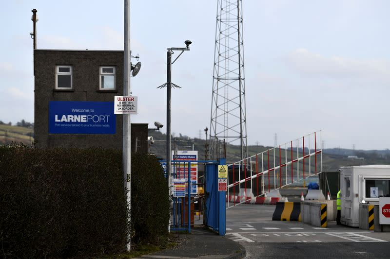 A sign is seen with a message against the Brexit border checks in relation to the Northern Ireland protocol at the harbour in Larne