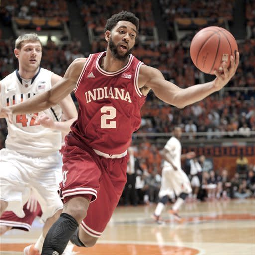 Indiana's Christian Watford (2) grabs a rebound in front of Illinois' Tyler Griffey (42) druing the first half of an NCAA college basketball game at Assembly Hall in Champaign, Ill., on Thursday, Feb. 7, 2013. (AP Photo/John Dixon)