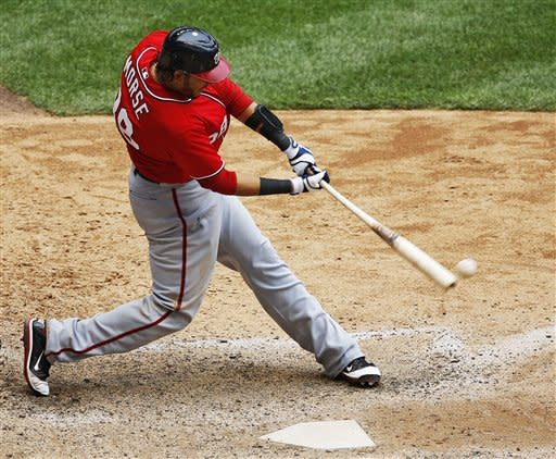 Washington Nationals' Michael Morse hits a two-RBI double off of Milwaukee Brewers' Jose Veras in the 11th inning of a baseball game, Sunday, July 29, 2012, in Milwaukee. (AP Photo/Tom Lynn)