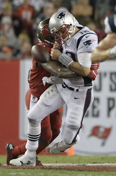 New England Patriots quarterback Tom Brady (12) fumbles after being hit by Tampa Bay Buccaneers outside linebacker Adarius Glanton during the third quarter of an NFL football game Thursday, Oct. 5, 2017, in Tampa, Fla. The Buccaneers recovered the fumble. (AP Photo/Phelan Ebenhack)