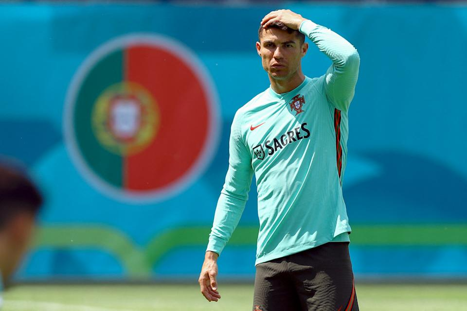Portugal's forward Cristiano Ronaldo gestures during a training session at the Illovszky Rudolf stadium in Budapest on June 11, 2021, ahead of their UEFA EURO 2020 football match against Hungary. (Photo by FERENC ISZA / AFP) (Photo by FERENC ISZA/AFP via Getty Images)