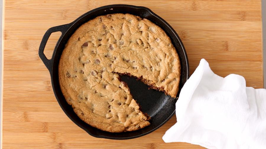 """<p>Consider this your new go-to <a href=""""https://www.marthastewart.com/275099/chocolate-chip-cookie-recipes"""" rel=""""nofollow noopener"""" target=""""_blank"""" data-ylk=""""slk:chocolate chip cookie recipe"""" class=""""link rapid-noclick-resp"""">chocolate chip cookie recipe</a>. Instead of forming individual balls of dough, why not form it into one crowd-friendly skillet cookie which you can bake, then slice into pieces for serving. <a href=""""https://www.marthastewart.com/1034356/skillet-chocolate-chip-cookie"""" rel=""""nofollow noopener"""" target=""""_blank"""" data-ylk=""""slk:View recipe"""" class=""""link rapid-noclick-resp""""> View recipe </a></p>"""