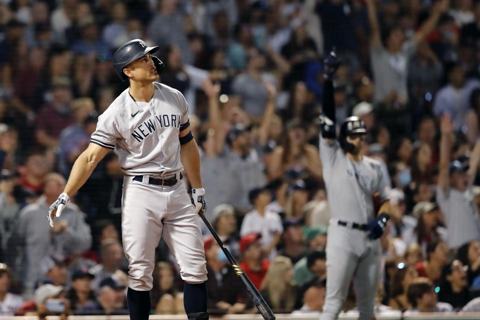 New York Yankees' Giancarlo Stanton watches his grand slam during the eighth inning of a baseball game against the Boston Red Sox, Saturday, Sept. 25, 2021, in Boston. (AP Photo/Michael Dwyer)
