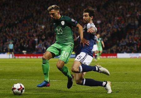 Britain Football Soccer - Scotland v Slovenia - 2018 World Cup Qualifying European Zone - Group F - Hampden Park, Glasgow, Scotland - 26/3/17 Slovenia's Kevin Kampl in action with Scotland's Charlie Mulgrew Action Images via Reuters / Jason Cairnduff Livepic