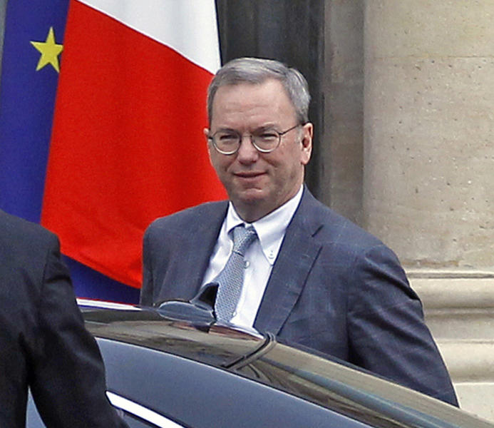 """FILE - In this Oct. 29 2012, file photo, Google executive chairman Eric Schmidt arrives at the Elysee Palace for a meeting with French President Francois Hollande, in Paris. Publishers in France, Germany and Italy want their governments to impose a """"news tax"""" on Google to save them from extinction, demanding a law that would charge the search engine small payments in exchange for links to stories. Google, in response, says it will cease to index the sites altogether, warning that the proposals do nothing to solve the industry's problems on the continent that invented the printing press. (AP Photo/Remy de la Mauviniere, File)"""