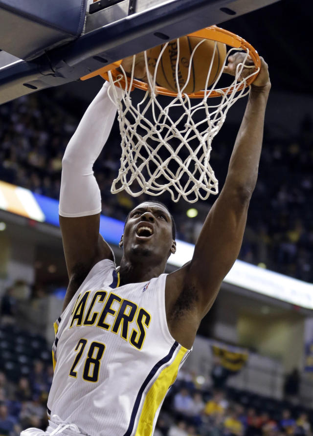 Indiana Pacers center Ian Mahinmi dunks in the second half of an NBA basketball game against the Denver Nugget in Indianapolis, Monday, Feb. 10, 2014. The Pacers won 119-80. (AP Photo/Michael Conroy)