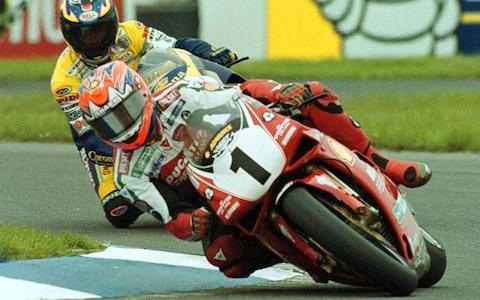 Great Britain's Carl Fogarty (1) riding a Ducati 996, on his way to winning race one of the Superbike World Championship at Donnington Park, England, Sunday, May 2 1999 - Credit: Rui Vieira/AP