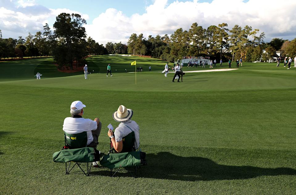 Two fans sit where two thousand would at a normal Masters. (Photo by Rob Carr/Getty Images)