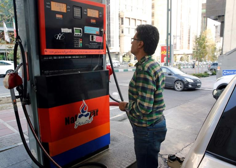 Iranians pump gas in Tehran in November 2019 amid a sudden hike in prices (AFP Photo/STR)