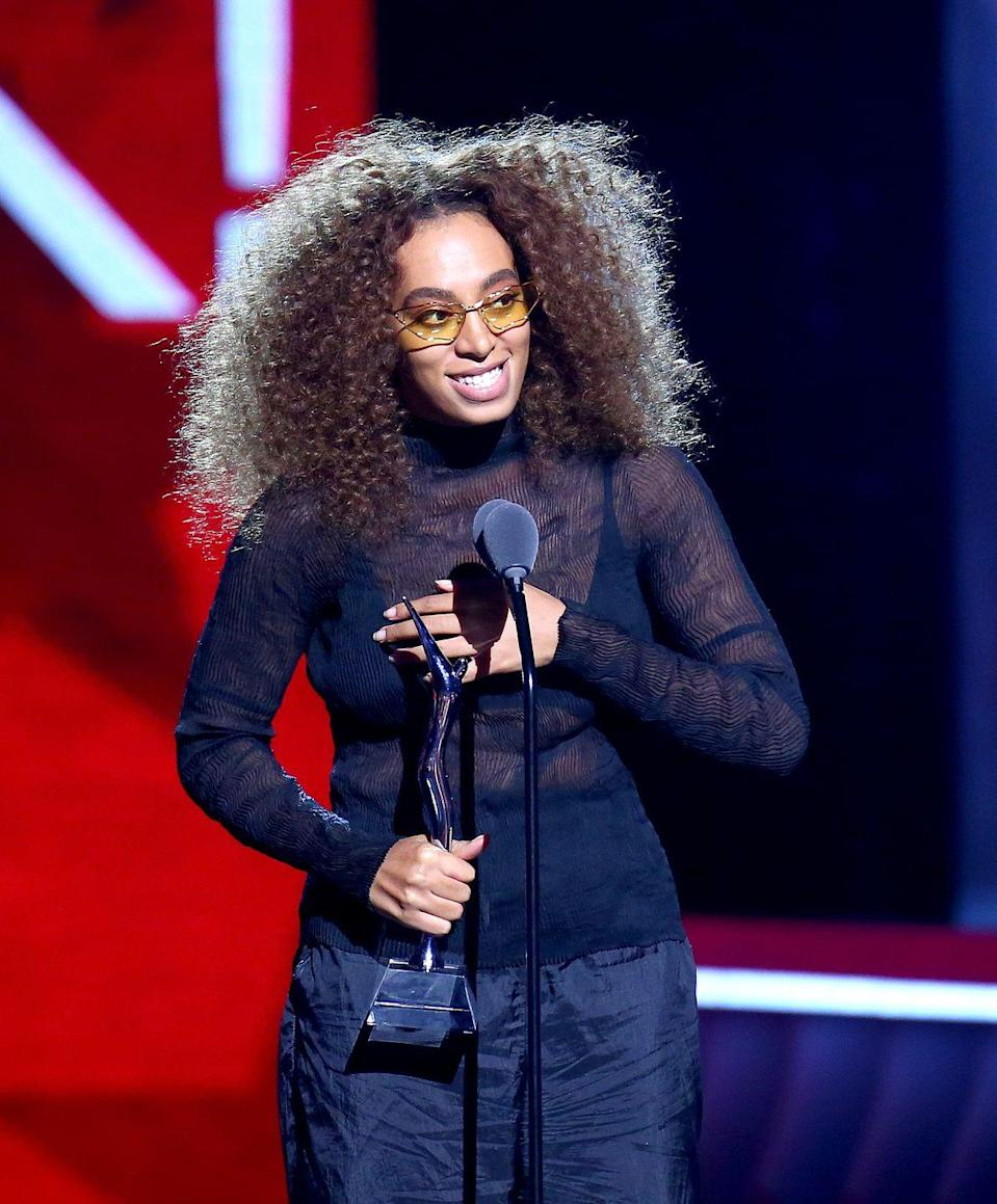 """<p><strong>Solange</strong> knows how to make her natural hair the star of the show. Try out a style like this by middle parting your hair, then letting it do its thing — you won't regret the gorgeous, super-voluminous results. For a bit of extra definition, dollop on some curl-defining cream. </p><p><a class=""""link rapid-noclick-resp"""" href=""""https://www.amazon.com/dp/B078NCGWZ2/?tag=syn-yahoo-20&ascsubtag=%5Bartid%7C10055.g.34691983%5Bsrc%7Cyahoo-us"""" rel=""""nofollow noopener"""" target=""""_blank"""" data-ylk=""""slk:SHOP CURL CREAM"""">SHOP CURL CREAM</a></p>"""