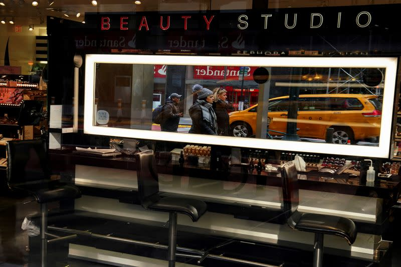 People walk past an empty beauty bar at Sephora following the outbreak of coronavirus disease (COVID-19), in the Manhattan borough of New York City