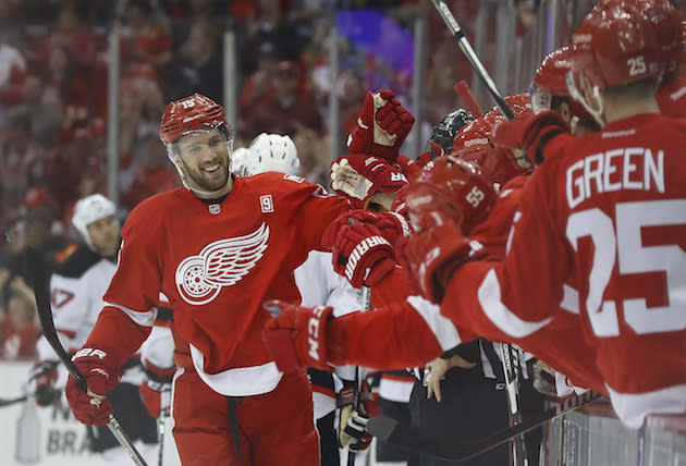 "<a class=""link rapid-noclick-resp"" href=""/nhl/teams/det/"" data-ylk=""slk:Detroit Red Wings"">Detroit Red Wings</a> center <a class=""link rapid-noclick-resp"" href=""/nhl/players/4981/"" data-ylk=""slk:Riley Sheahan"">Riley Sheahan</a> (15) celebrates his goal against the <a class=""link rapid-noclick-resp"" href=""/nhl/teams/njd/"" data-ylk=""slk:New Jersey Devils"">New Jersey Devils</a> during the first period of the final NHL hockey game at Joe Louis Arena, Sunday, April 9, 2017, in Detroit. (AP Photo/Paul Sancya)"