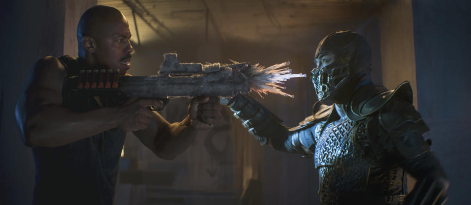 "This image released by Warner Bros. Pictures shows Mehcad Brooks, left, and Joe Taslim in a scene from ""Mortal Kombat."" (Mark Rogers/Warner Bros. Pictures via AP)"