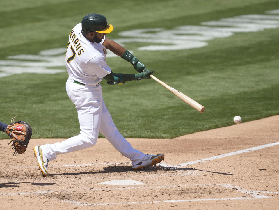 Oakland Athletics' Elvis Andrus (17) hits a single against the Detroit Tigers during the fourth inning of a baseball game on Saturday, April 17, 2021, in Oakland, Calif. (AP Photo/Tony Avelar)
