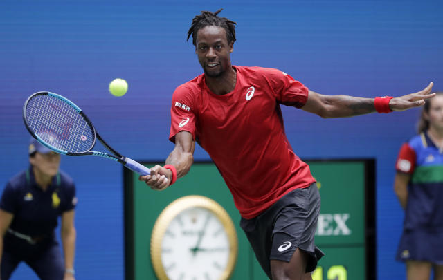 Gael Monfils, of France, returns to Matteo Berrettini, of Italy, during the quarterfinals of the U.S. Open tennis championships Wednesday, Sept. 4, 2019, in New York. (AP Photo/Frank Franklin II)