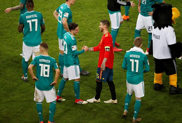 Soccer Football - International Friendly - Germany vs Spain - ESPRIT arena, Dusseldorf, Germany - March 23, 2018 Germany's Mesut Ozil shakes hands with Spain's Sergio Ramos after the match REUTERS/Wolfgang Rattay