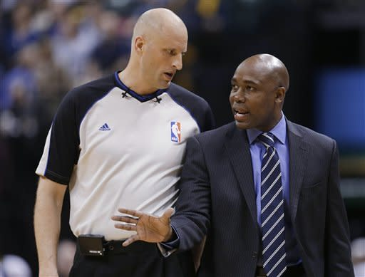 Orlando Magic coach Jacque Vaughn argues a call with referee Eric Dalen during the first half of an NBA basketball game against the Indiana Pacers on Tuesday, March 19, 2013, in Indianapolis. (AP Photo/Darron Cummings)
