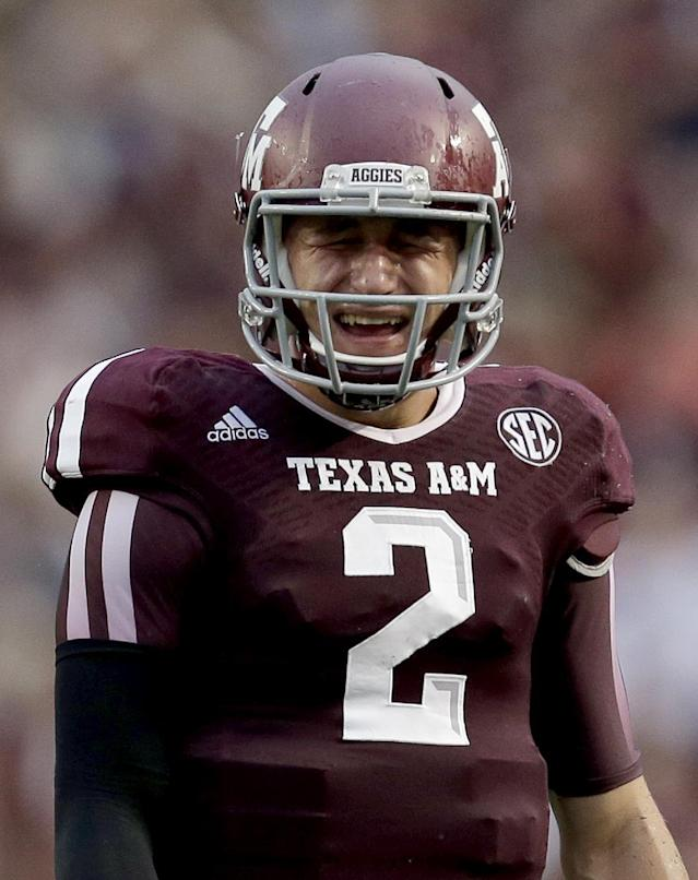 Texas A&M quarterback Johnny Manziel (2) reacts after a penalty call against Texas A&M during the second quarter of an NCAA college football game against Sam Houston State Saturday, Sept. 7, 2013, in College Station, Texas. (AP Photo/David J. Phillip)