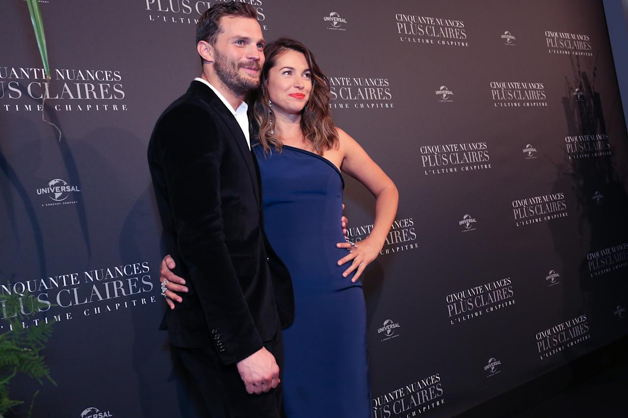 <p>Rita Ora, Jamie Dornan, and Dakota Johnson photographed for the Fifty Shade Freed Premiere on Feb 6, 2018 in Paris, France. (Photo by Olivier VIGERIE / Contour by Getty Images) </p>
