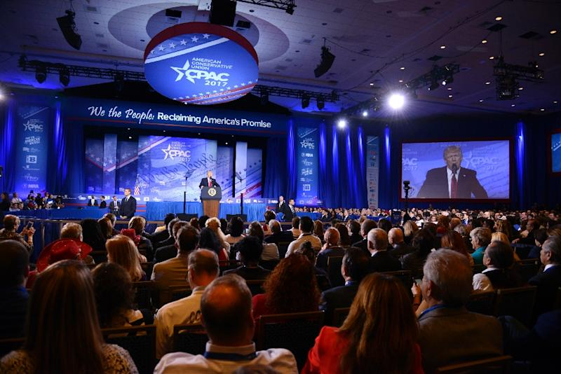 Attendees of the Conservative Political Action Conference (CPAC) watch US President Donald Trump give a speech at the National Harbor in Maryland, on February 24, 2017 (AFP Photo/Mike Theiler)