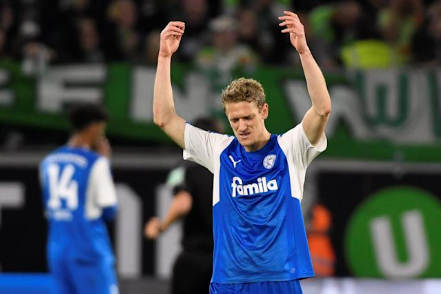 Soccer Football - Bundesliga Promotion/Relegation Playoff First leg - VfL Wolfsburg v Holstein Kiel - Volkswagen Arena, Wolfsburg, Germany - May 17, 2018 Holstein Kiel's Johannes van den Bergh reacts REUTERS/Fabian Bimmer DFL RULES TO LIMIT THE ONLINE USAGE DURING MATCH TIME TO 15 PICTURES PER GAME. IMAGE SEQUENCES TO SIMULATE VIDEO IS NOT ALLOWED AT ANY TIME. FOR FURTHER QUERIES PLEASE CONTACT DFL DIRECTLY AT + 49 69 650050