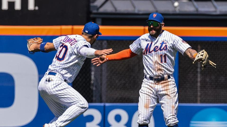 New York Mets center fielder Kevin Pillar (11) celebrates with right fielder Michael Conforto (30) after their game against the Baltimore Orioles at Citi Field.