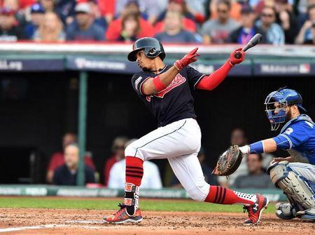Oct 15, 2016; Cleveland, OH, USA; Cleveland Indians shortstop Francisco Lindor (12) hits an RBI single against the Toronto Blue Jays during the third inning of game two of the 2016 ALCS playoff baseball series at Progressive Field. Mandatory Credit: Ken Blaze-USA TODAY Sports