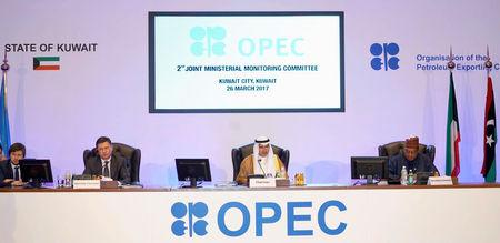 Kuwait Oil Minister Ali Al-Omair gives his opening speech during OPEC 2nd Joint Ministerial Monitoring Committee meeting as Russian Energy Minister Alexander Novak and OPEC Secretary General Mohammad Barkindo attend the meeting in Kuwait City